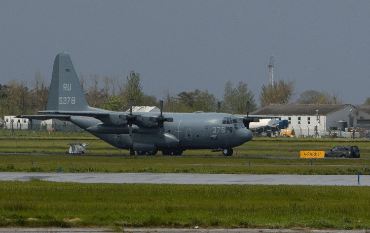 A US military C130 transport plane under armed guard at Shannon – Photo: © Pat Flynn 2014