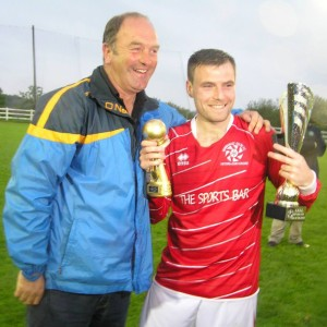 Donie Garrihy presents the Man of the Match award to David McCarthy. Picture: Oliver Fitzpatrick