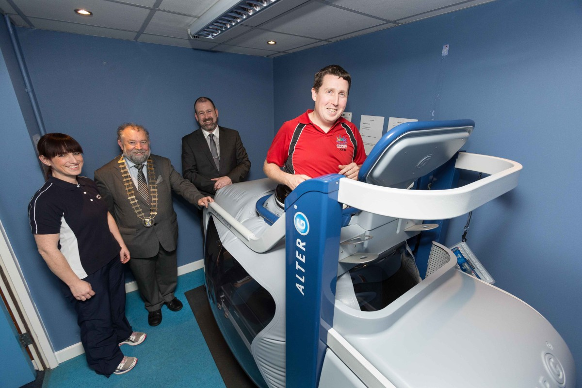 John Carey, Gym Manager along with Tim Forde , General manager and Anne-Marie Kinsella, Chartered Physio Therapist demonstrating the new anti-gravity AlterG treadmill at Active Ennis Leisure complex for John Crowe, Cathaoirleach Clare County Council. Photograph by Eamon Ward