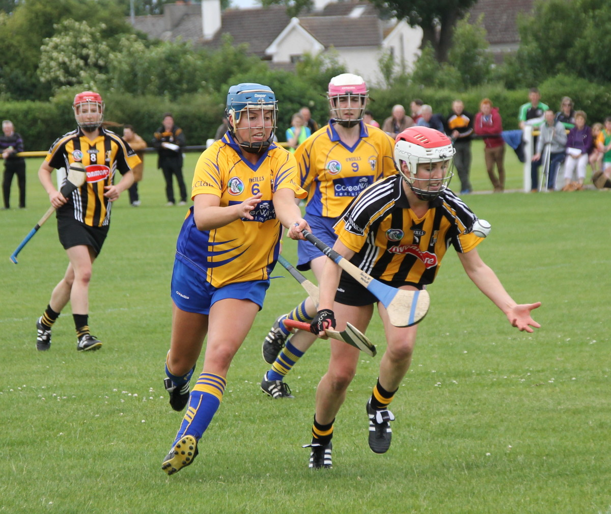 Camogie Kilkennys Edel Maher tries to get away from Clares Roisin McMahon
