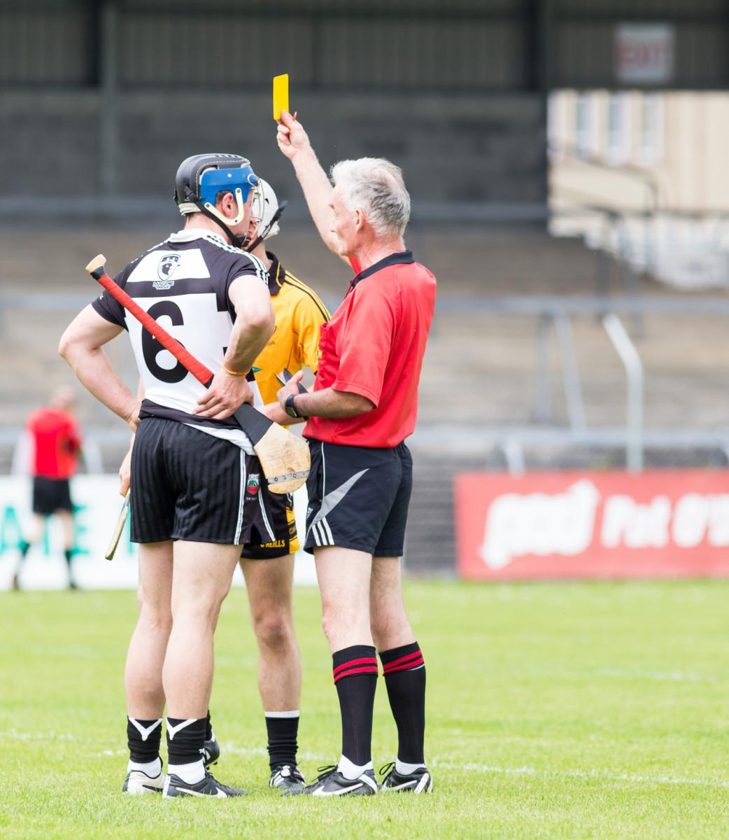 Ambrose Heagney shows a yellow card to Adam Healy. Pic: John Meyler