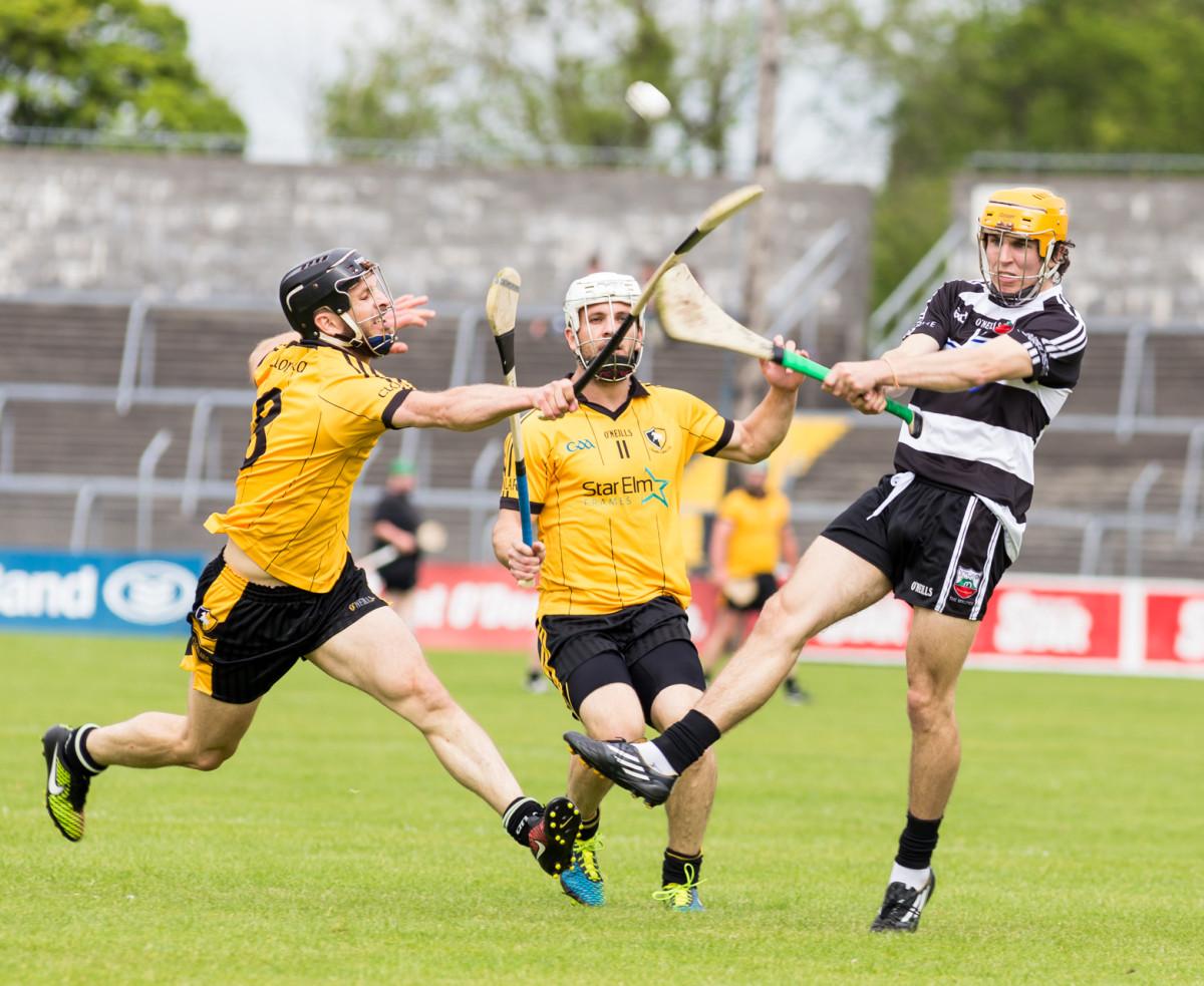 Domhnall O'Donovan gets a block in on Stephen Ward's strike. Picture: John Meyler