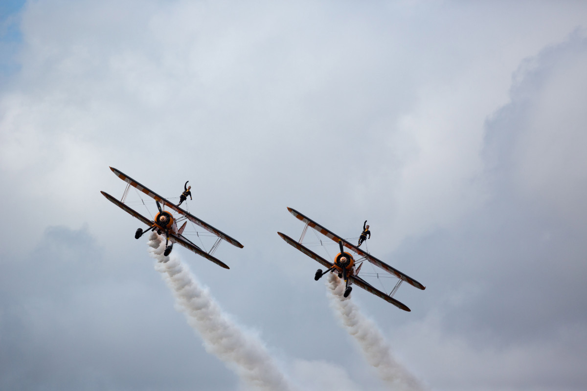 The Breitling Wingwalkers from left: lead pilot (3) David Barrell with wing walker Danielle Hughes and Martyn Carrington (2), with wing walker Lydia Beadle in the 2014 Foynes Air Show 15,000 turned up for the centrepiece of the celebrations involving up 30 different aircraft.  Pic Fusion Shooters