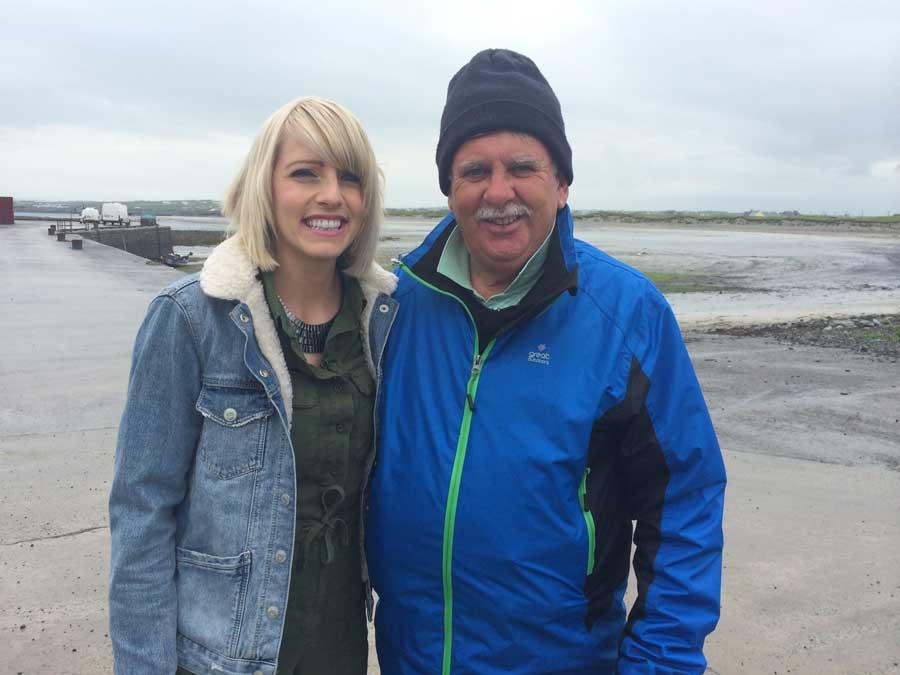 Presenter Máire Treasa Ní Dhubhghaill and Seán Ó Treasaigh at Seafield Pier, Quilty