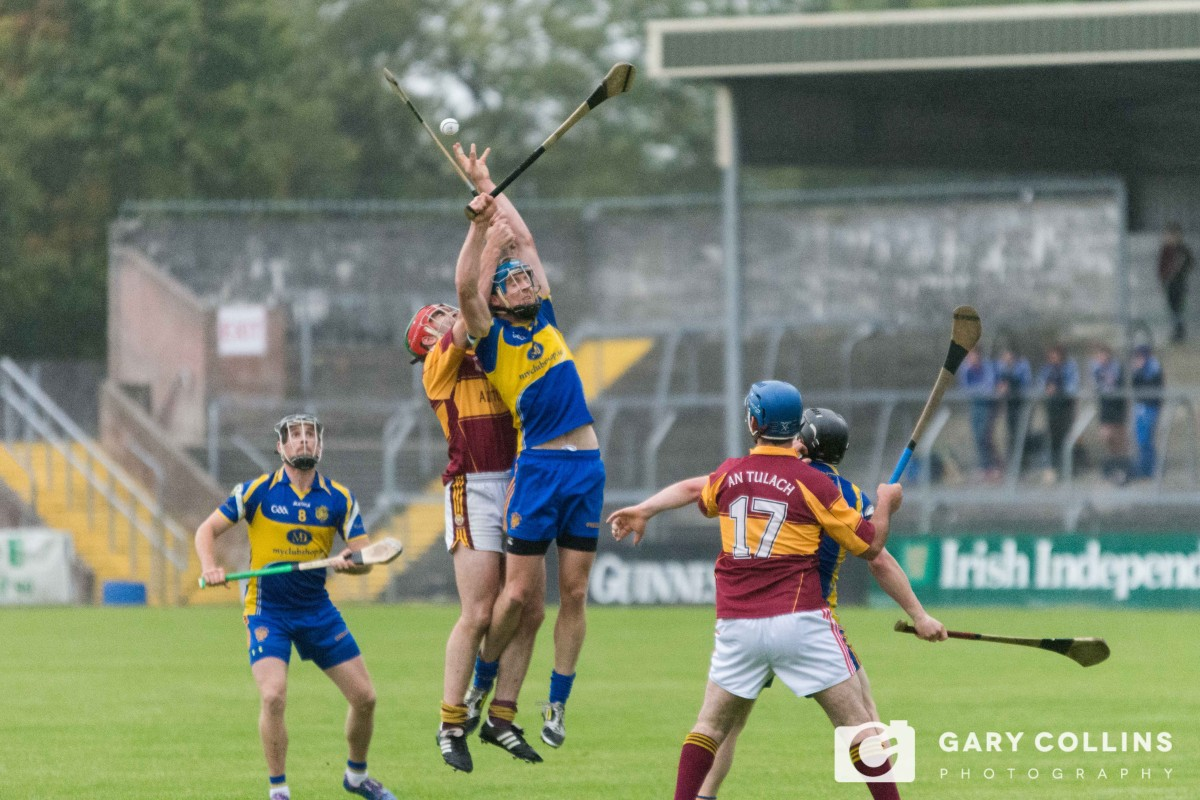 David Barrett and Eugene Cooney compete for the aerial ball. Picture: John Meyler