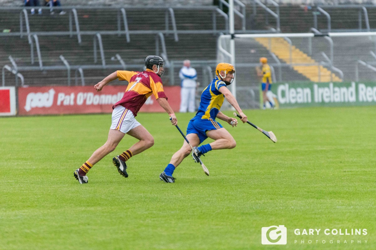 Alan Barrett prepares to clear his lines ahead of Darragh Corry. Picture: Gary Collins