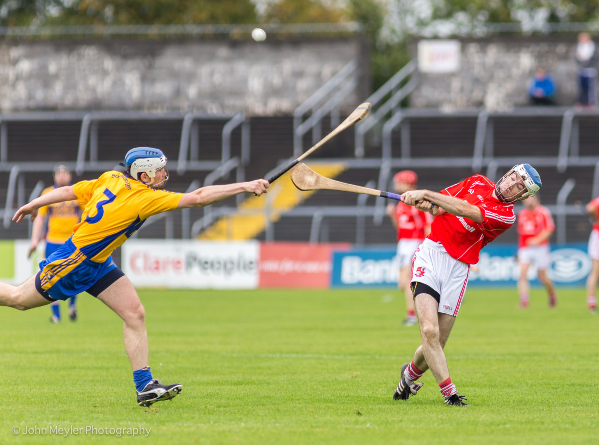 Paddy Vaughan gets his strike in despite the best efforts of Aidan Quilligan.