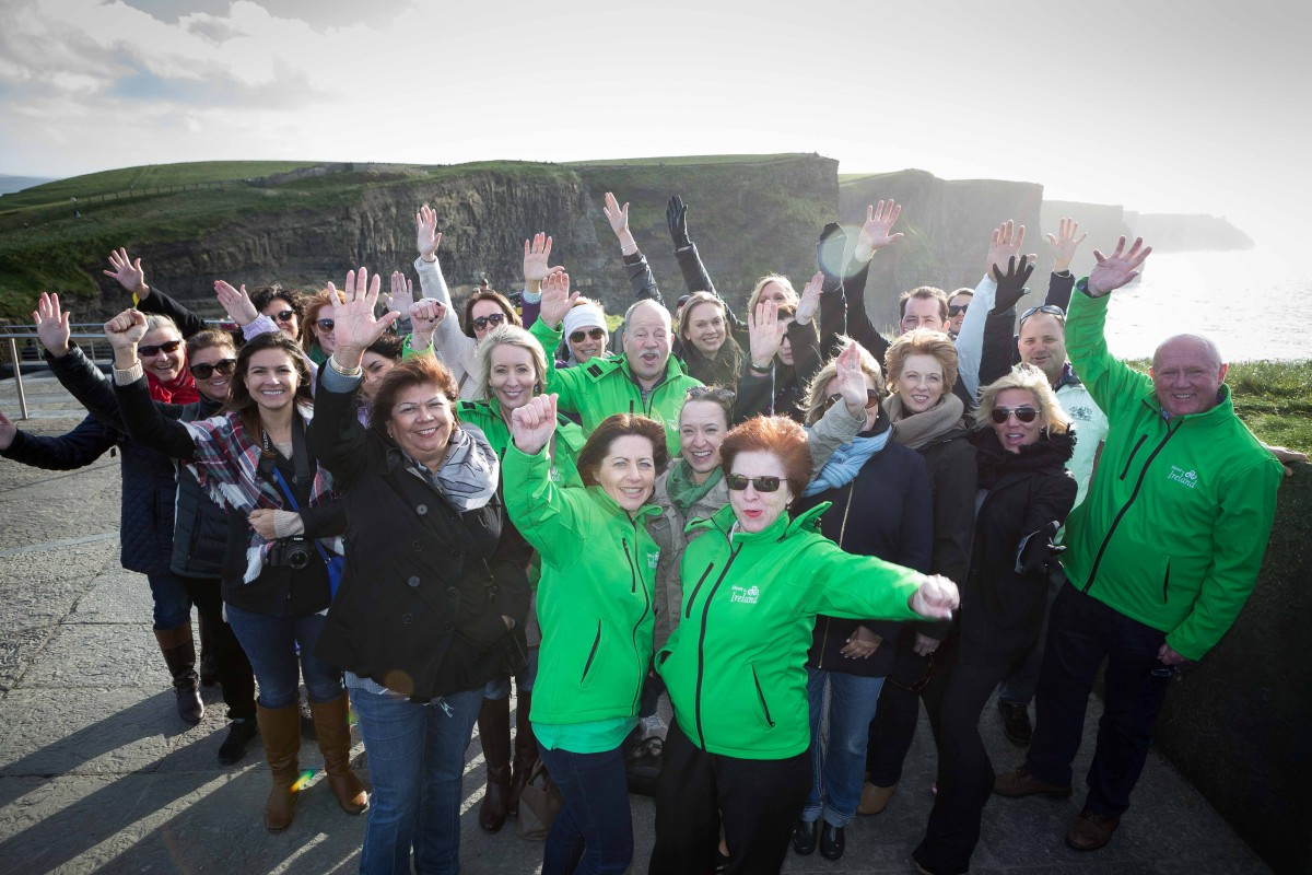 """Ciara Gallagher ,Faílte Ireland and Marie McKown, Tourism Ireland (front) with a group of International Meeting planners from North America and Canada visiting the Cliffs of Moher, County Clare as part of their five day program in Ireland while attending """"Meet in Ireland 2015"""" which took place in the Royal Hibernian Academy, Dublin. Photograph by Eamon Ward"""