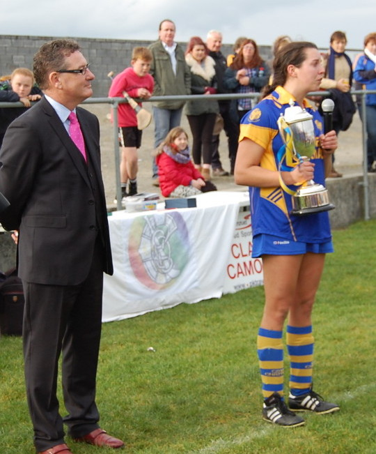 Newmarket-on-Fergus captain Roisin McMahon pictured alongside Clare Camogie Chairperson Joe Robbins. Picture: Veronica McMahon