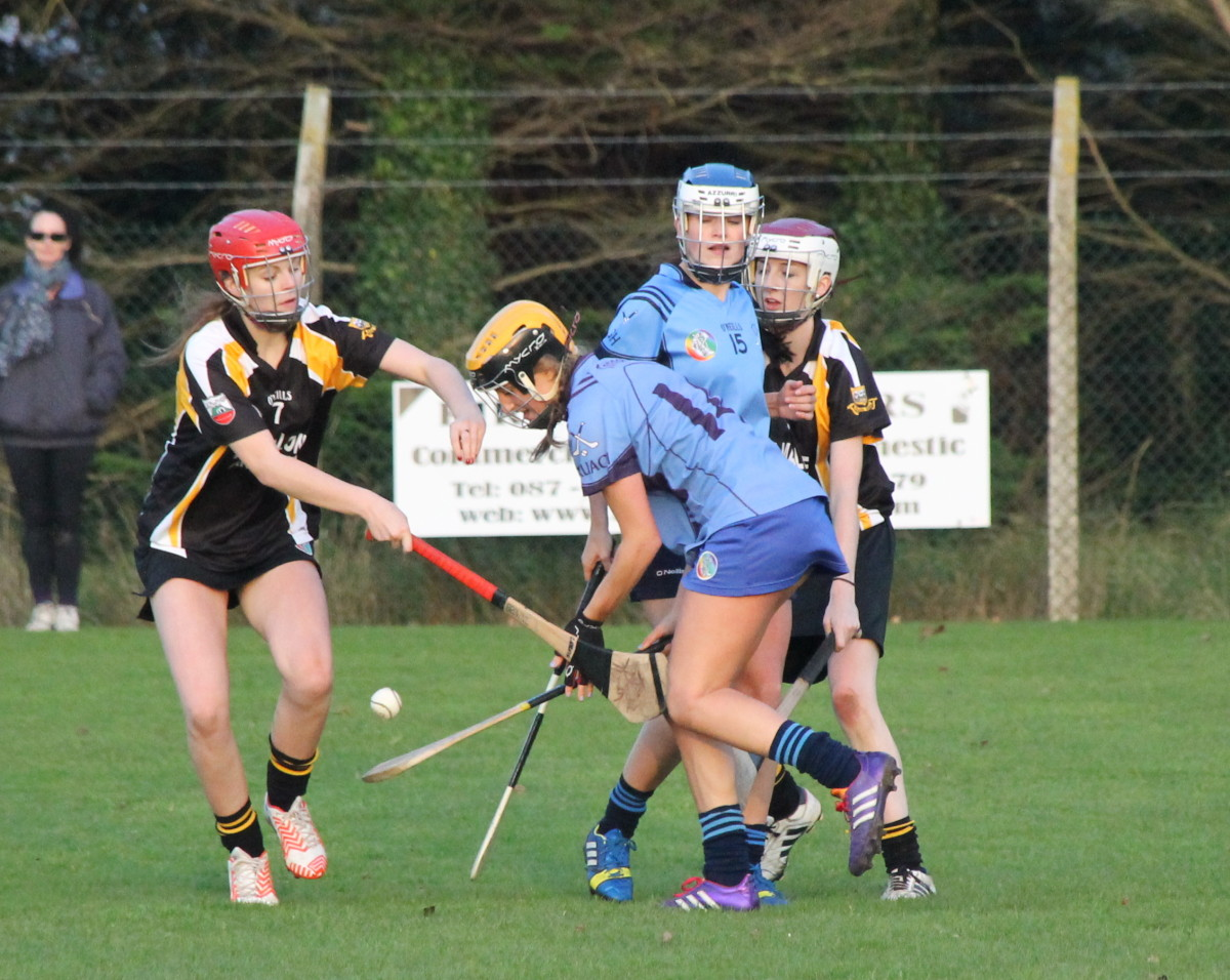 Truagh Clonlaras Ellen Horgan under pressure from ClarecastleBallyeas Carol Browne. Picture: Caroline O'Keeffe