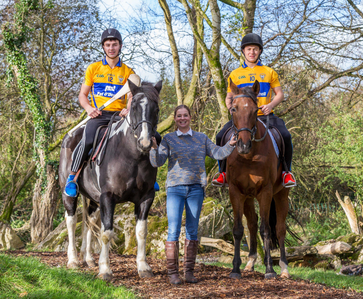 Clare Senior Hurling players Peter Duggan (left) and David Reidy (right) pictured with Karen McLoughney Hannon of Killulla Stud, Newmarket on Fergus, County Clare, launching the Clare Hurling Race Night, which takes place in Treacy's West County Hotel, Ennis, County Clare, on Monday 28th December. Pic credit John Meyler.