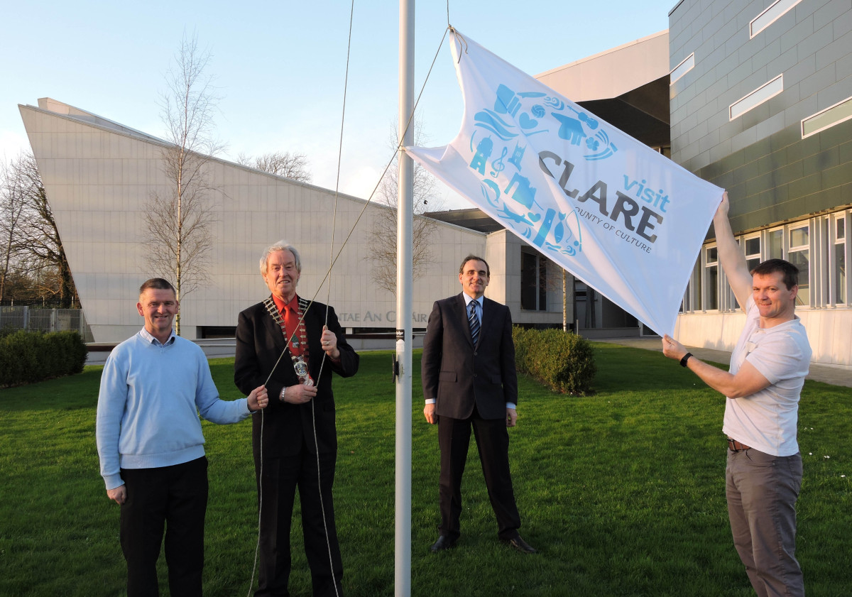 In photo is l-r John Mc Inerney (Facilities Team, Clare County Council), Cllr James Breen, Cathaoirleach of Clare Co Council, Gerard Dollard, Director of Services and Patrick Mc Namara (Facilities Team, Clare County Council) pictured raising the County of Culture flag outside Áras Contae an Chláir ahead of the launch on January 2nd.