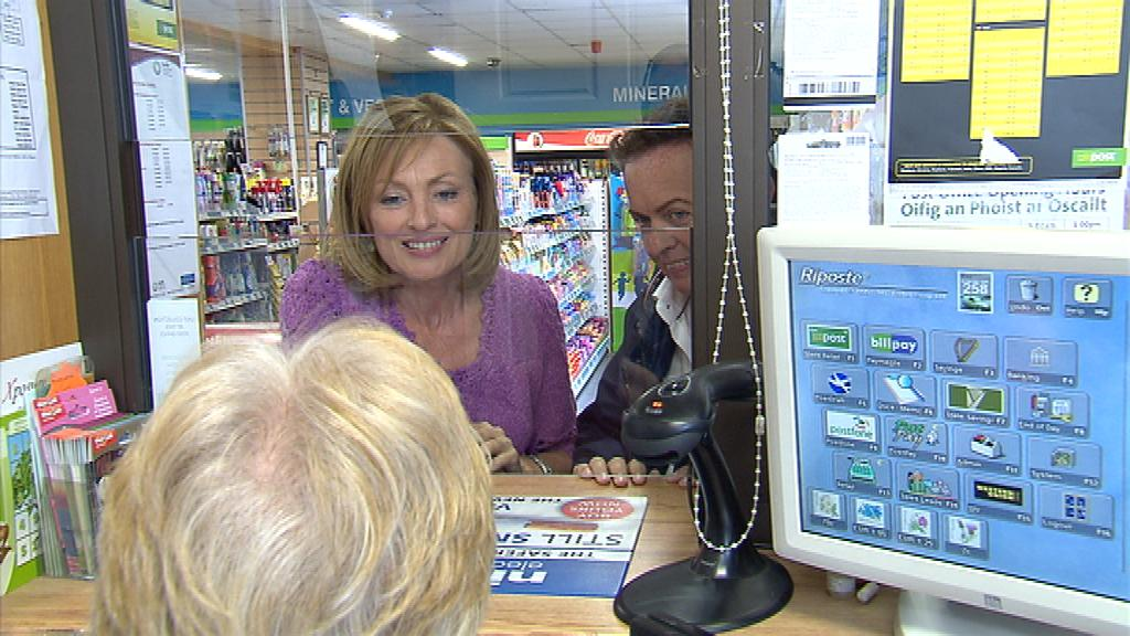 Marty and Mary talking to the postmistress Beatrice O'Riordan of Quilty Post office