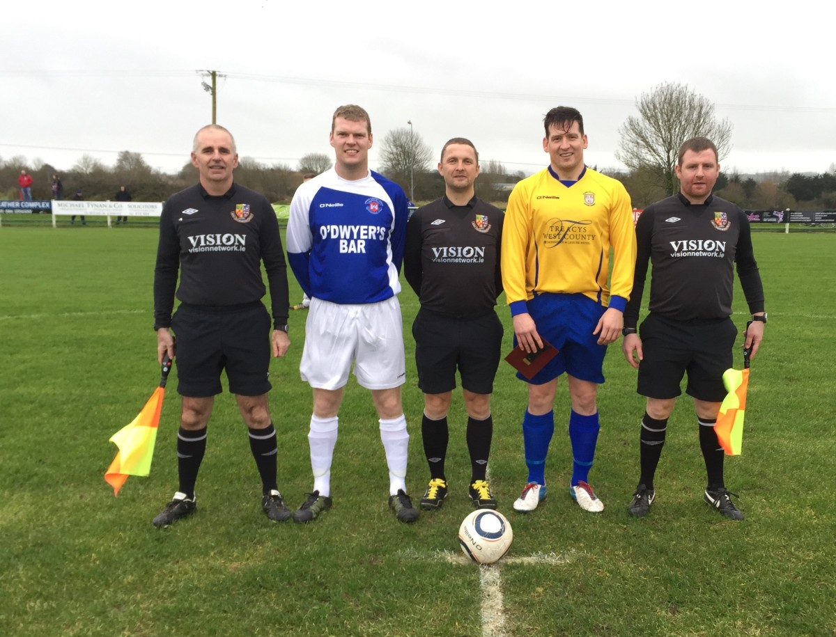 Captains Eoin Hanrahan (Limerick) & Paddy Purcell (Clare) with the match officials.