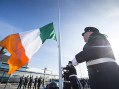 Pictured during the flag-raising ceremony are Shannon Airport Police officers, from left, Brian Corry, from Newmarket-on-Fergus, Co. Clare, David McNamara, from Kilkishen, Co. Clare, and Richard Moloney, from Bruff, Co. Limerick. Shannon Airport, Co. Clare. Picture credit: Diarmuid Greene/Fusionshooters