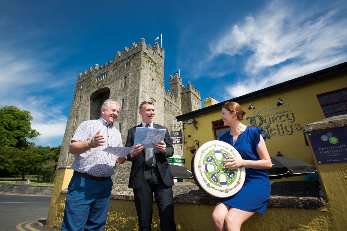 Pictured outside the world famous Durty Nelly's of Bunratty at the launch of Clare.ie, Clare Tourism's new website, ahead of 400,000 visitors to the county for the Fleadh Cheoil na hÉireann this August from left: Maurice Walsh, Durty Nelly's, Paul Madden, Chair Clare Tourism and Maureen Cleary, Marketing Executive for Clare Tourism. Pic Sean Curtin