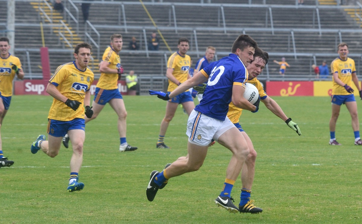 Jamie Malone powers past the Roscommon defence. Pic: Martin Connolly