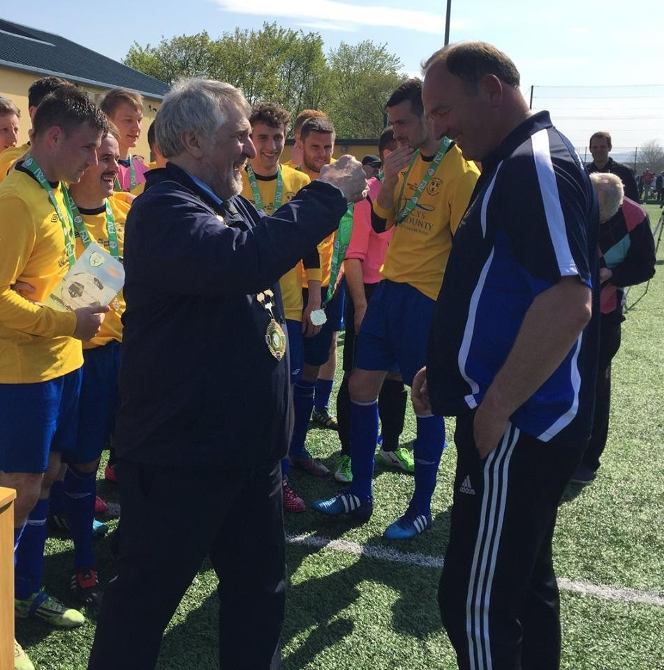 Donie Garrihy receiving a medal for Clare's Oscar Traynor success.