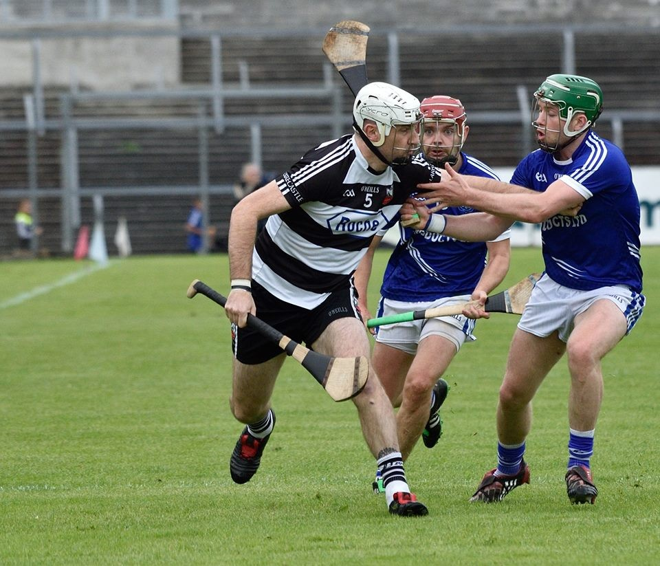 Jamie O'Connor under pressure from Cathal McInerney. Pic: Martin Connolly
