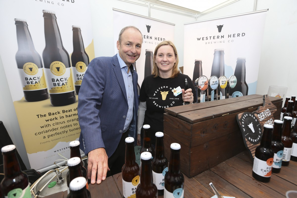 Fianna Fáil Leader Micheál Martin TD with Maeve Sheridan from Wester Herd Brewing  at the 2016 National Ploughing Championships, Screggan, Tullamore. Pic: Conor McCabe