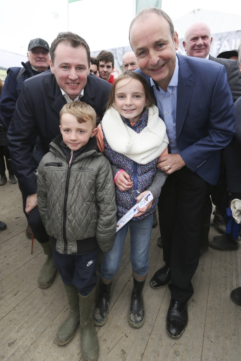 Fianna Fáil Leader, Micheál Martin TD, and Agriculture Spokesperson, Charlie McConologue TD with Roisin (age 10) and Caoimhin (age 7) from Shannon, Co Clare at the 2016 National Ploughing Championships, Screggan, Tullamore, Co Offaly. Pic: Conor McCabe