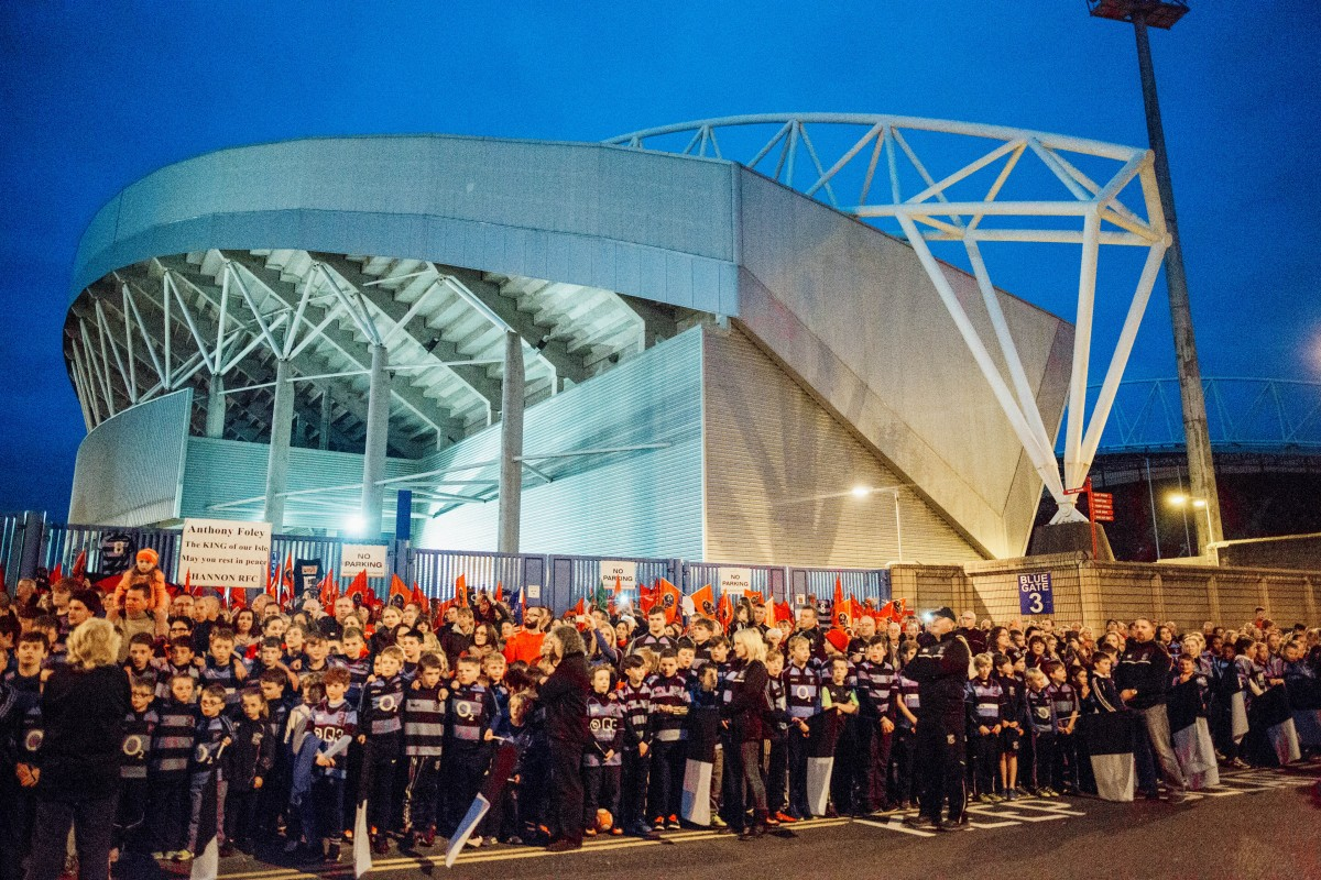 Huge crowds gather at Thomond Park as the body of Anthony Foley returns home - Photo: Brian Arthur