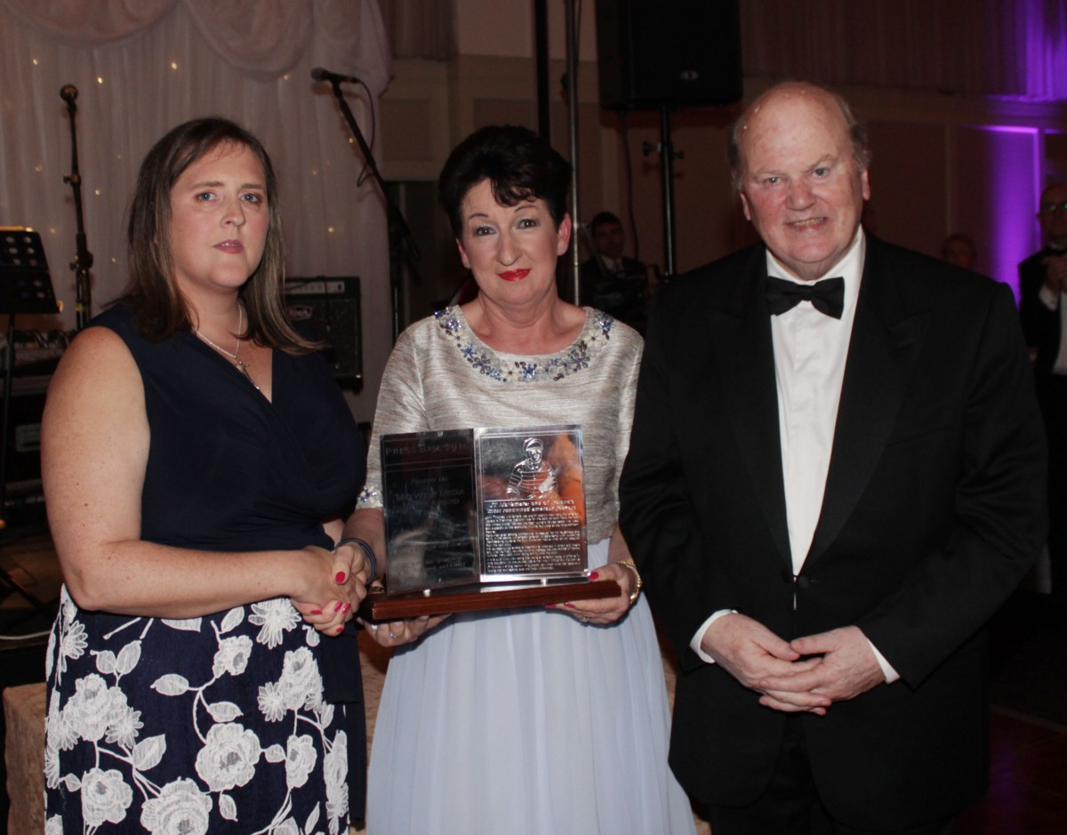 Caroline McNamara accepts the Shannon Group Media Merit Award from Rose Hynes & Michael Noonan. Pic: Michael Cowhey