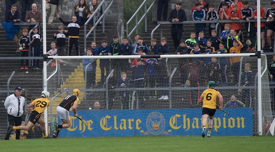 Gary Brennan flicks the sliotar to the back of the net. Pic: Martin Connolly