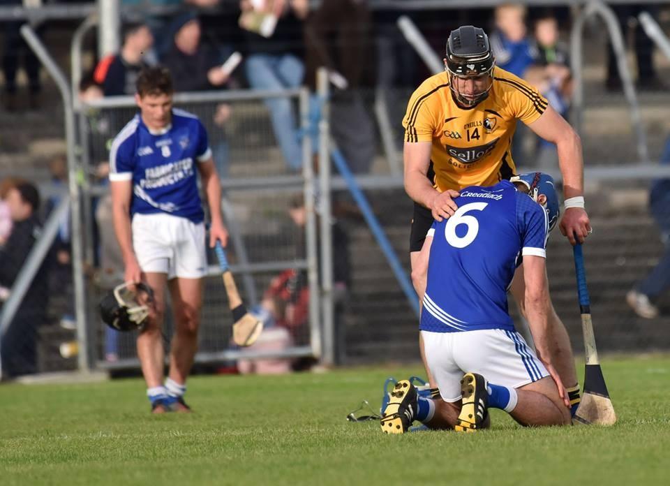 John Conlon consoles Conor Ryan at the final whistle. Pic: Martin Connolly